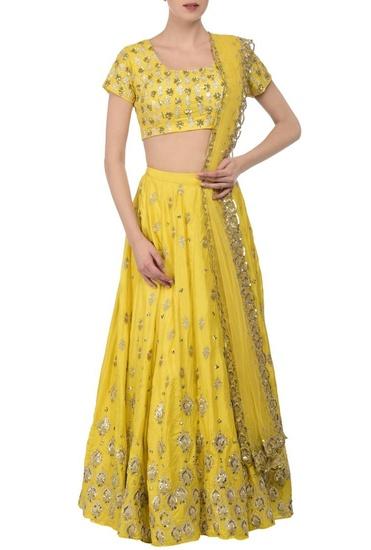 Latest Collection of Lemon yellow & silver embroidered lehenga set by Astha Narang