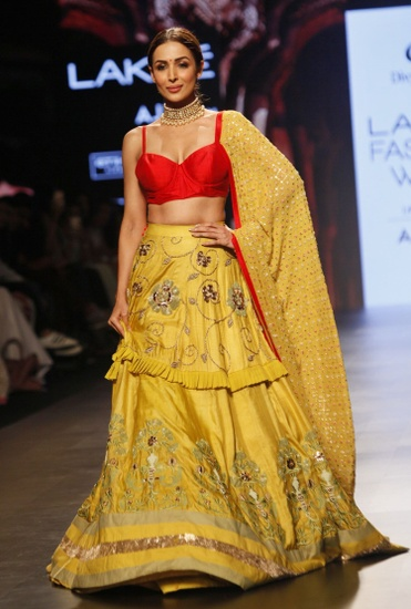 Latest Collection of Red & yellow bralette and embroidered lehenga by Divya Reddy