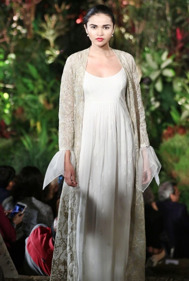 Latest Collection of  Ivory sleeveless gown & embroidered jacket  by Anita Dongre