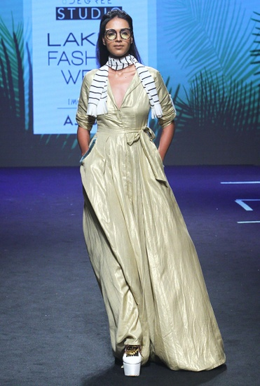 Latest Collection of Gold long dress with waist tie up  by Vidhi Wadhwani