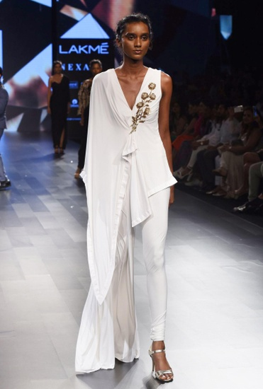 Latest Collection of White asymmetrical jumpsuit by Sonaakshi Raaj