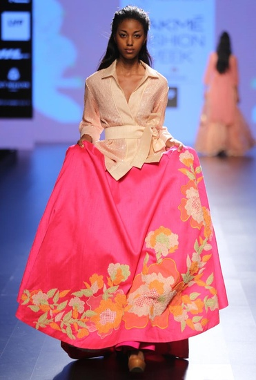Latest Collection of Pale pink jacket with fuschia floral applique lehenga by Neeta Lulla