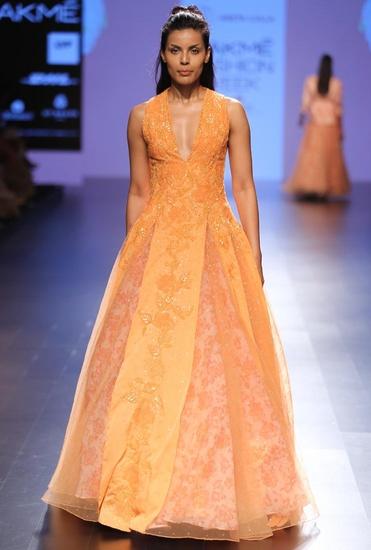 Latest Collection of Tangerine embellished anarkali with pink lehenga by Neeta Lulla