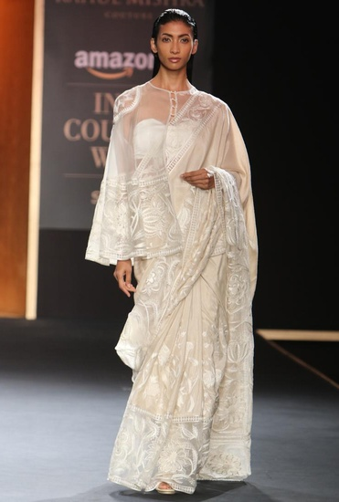 Latest Collection of Ivory hand embroidered sari with cape by Rahul Mishra