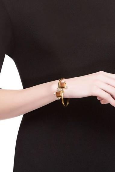 Gold bangle with swarovski crystals