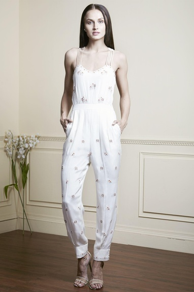 White jumpsuit with hand embellished neckline