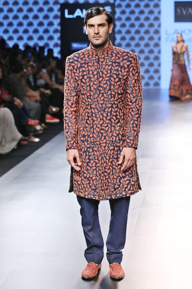Blue sherwani with orange jaal work