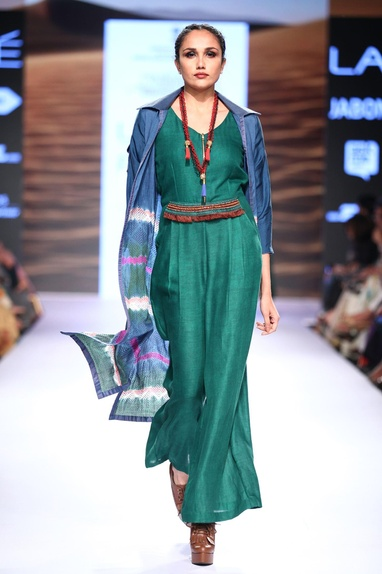 Green jumpsuit with embroidered jacket