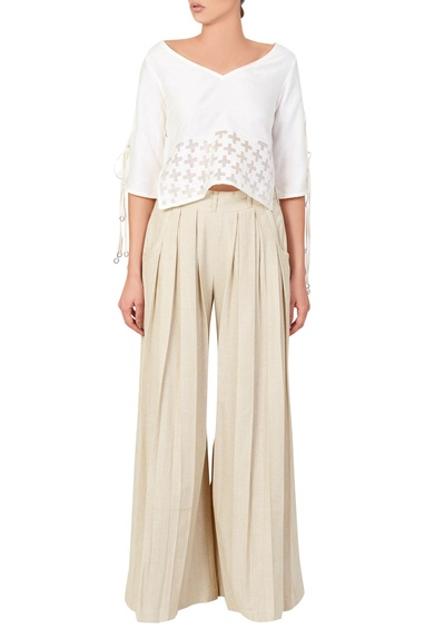 White blouse & box pleated trousers