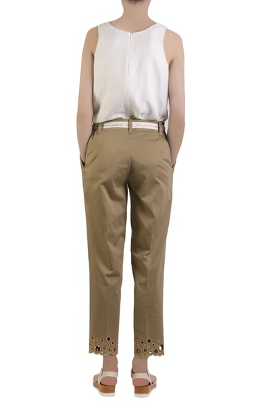 Beige trousers in polka dot embroidery