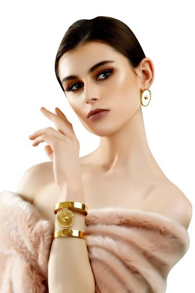 Gold plated brass medallion cuffs