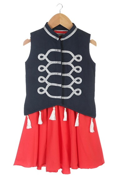 Blue sleeveless military jacket with red dress