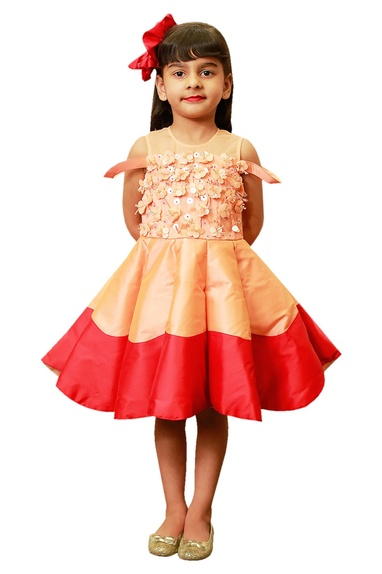Peach-red CU cut frock with 3D flowers.