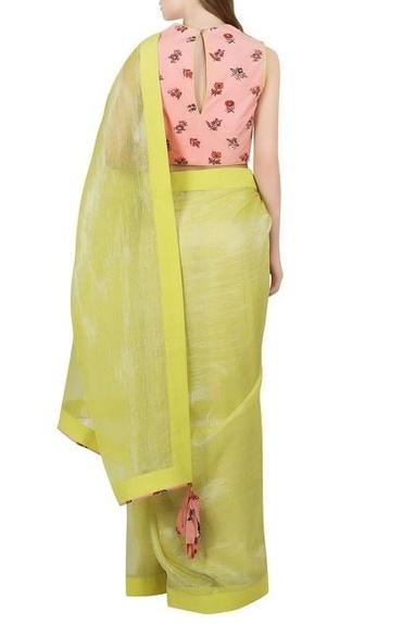 Green sari with salmon pink printed blouse