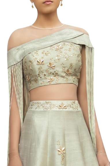 Raw silk embroidered lehenga with tassel blouse