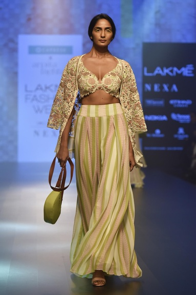 Striped pants with embroidered bustier & cape