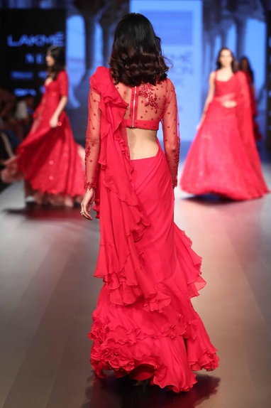 Ruffle border sari with embroidered blouse