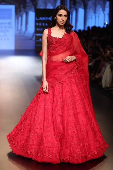 Sequin embroidered lehenga with sleeveless blouse and dupatta