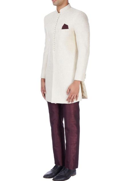 Ivory sherwani with wine trousers