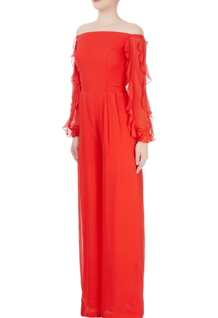 Red jumpsuit with ruffled sleeves