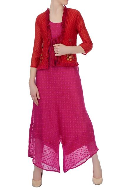 Pink jumpsuit & hand-embellished red jacket