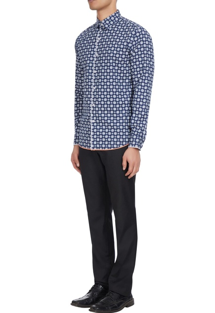 Floral printed shirt with detailed buttons.