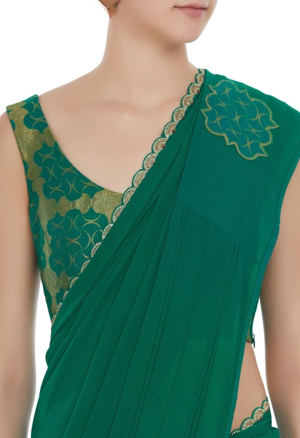 Geometrical weave saree with sleeveless blouse.
