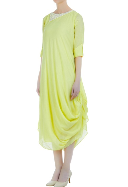Cowl style tunic with embroidered neckline.