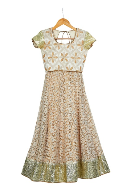 Beige pre-embroidered net lehenga with choli blouse & dupatta