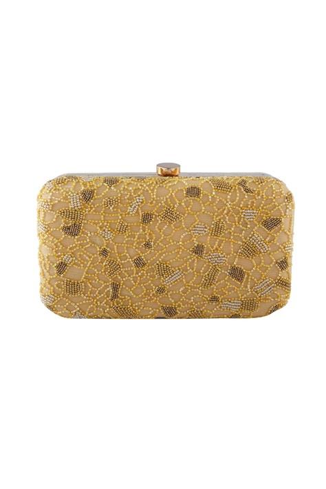 Beige clutch with yellow bead embellishments