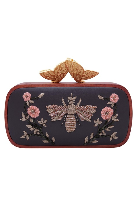 Embroidered clutch with gold butterfly handle