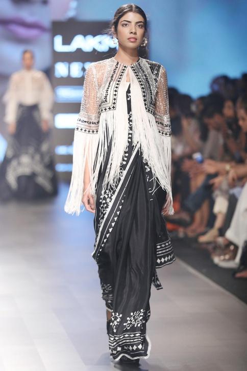 White & black silk sari with off-shoulder blouse