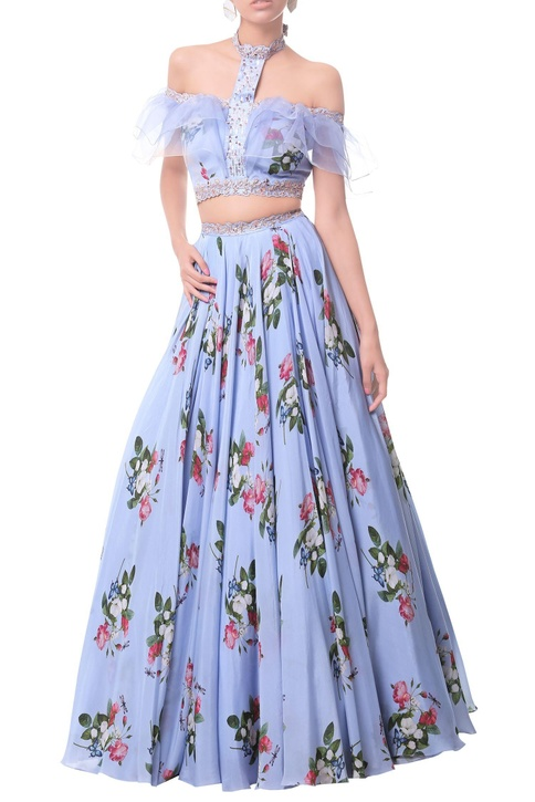 Powder blue off-shoulder ruffle blouse with floral lehenga