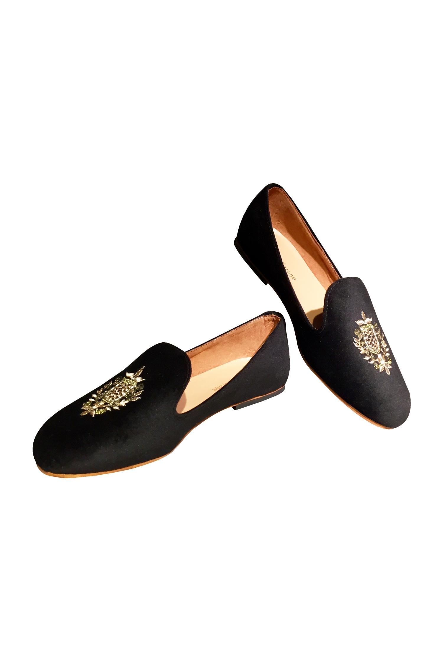 Black velvet handcrafted loafers.
