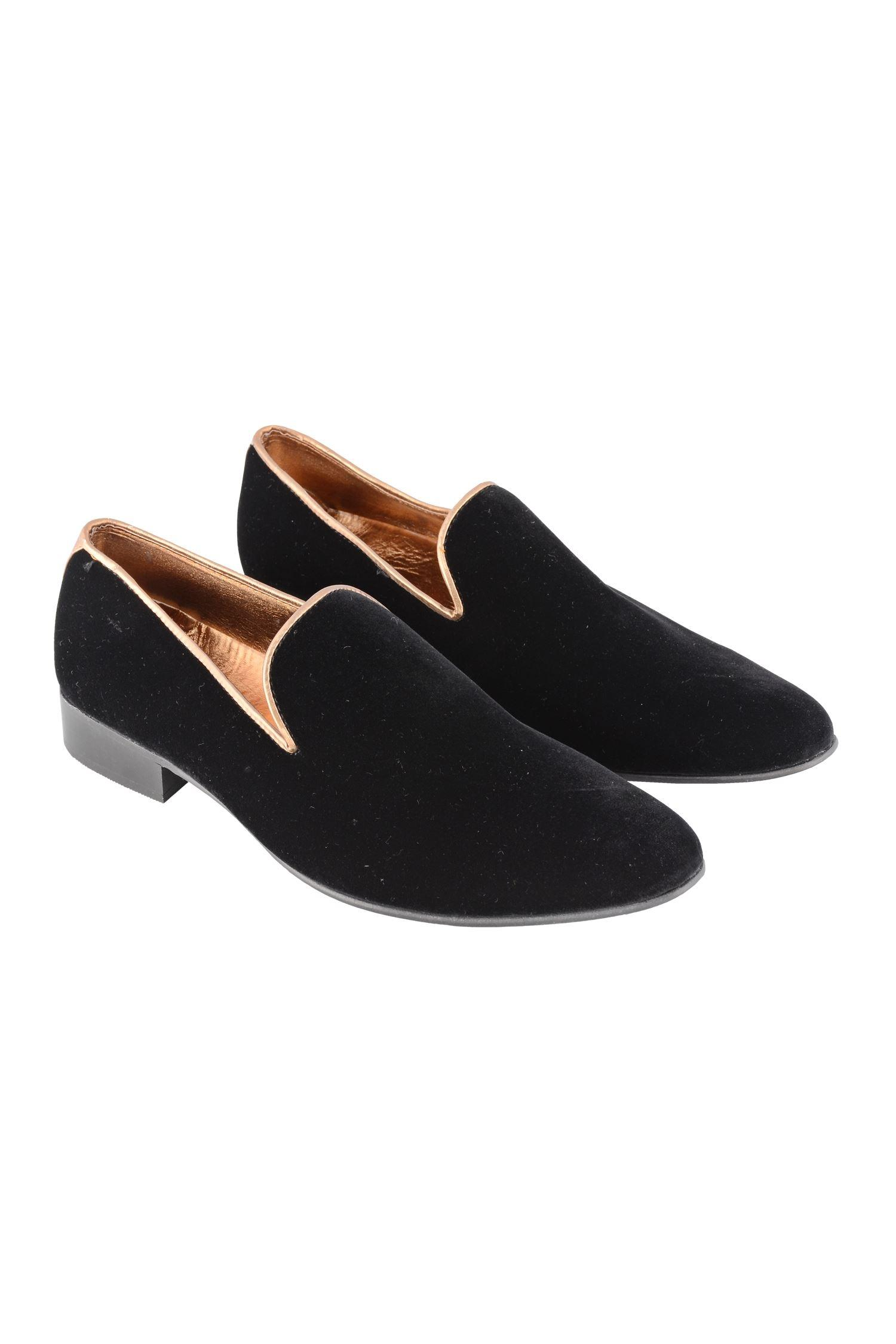 Black loafers with gold piping