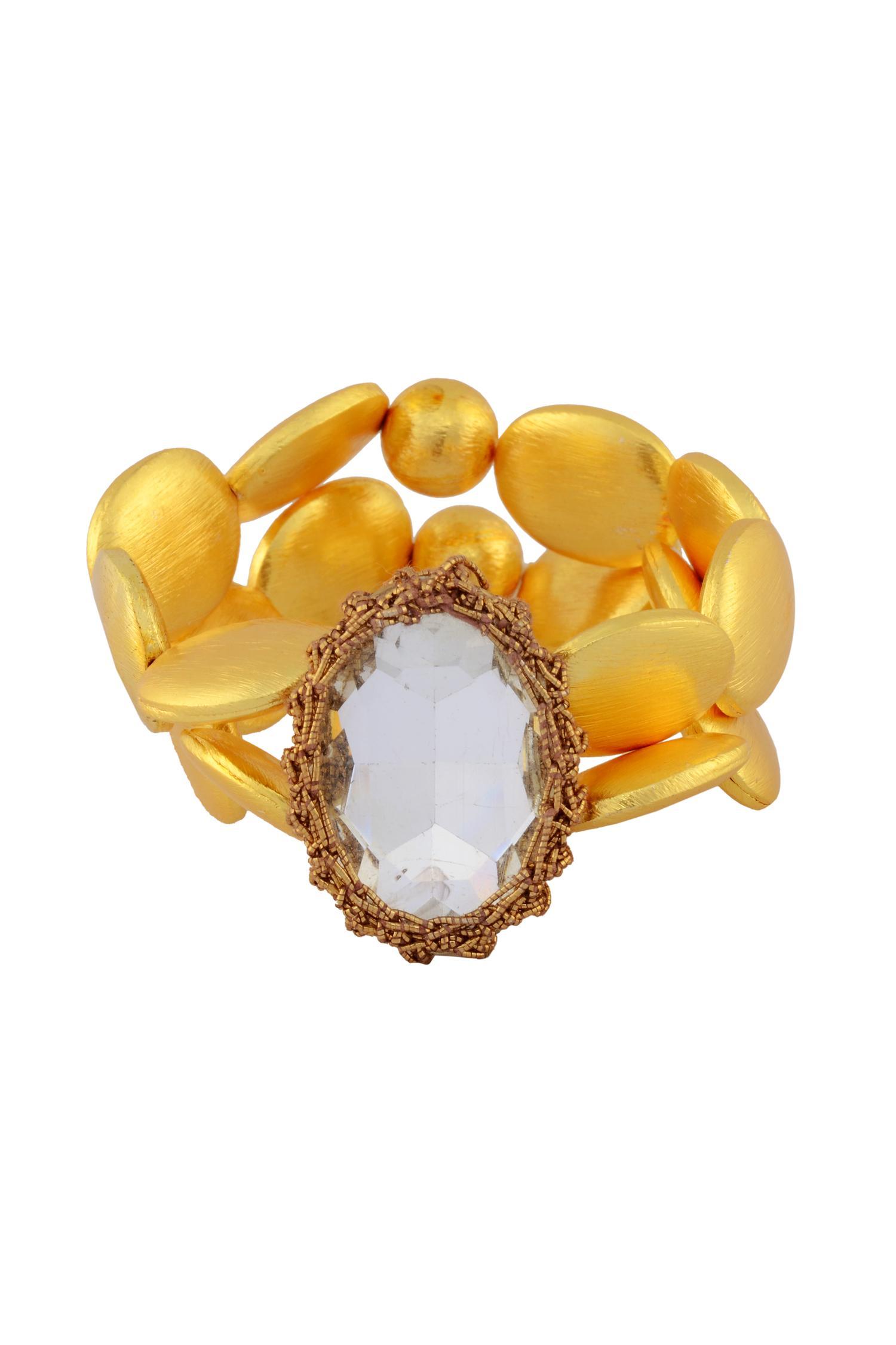 Shilpa PuriiGold bracelet with a stone