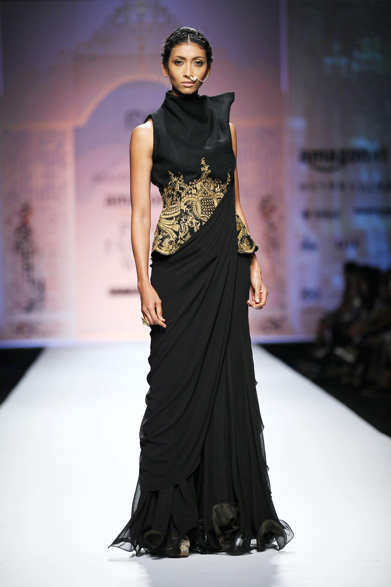 Buy Black ruffled sari gown by Mandira Wirk at Aza Fashions