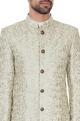 Light green silk jaal & zari embroiered sherwani with kurta & churidar