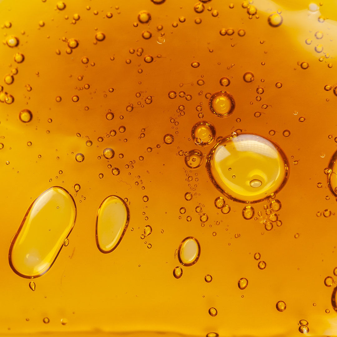 Extracted CBD oil from hemp and bubbles inside