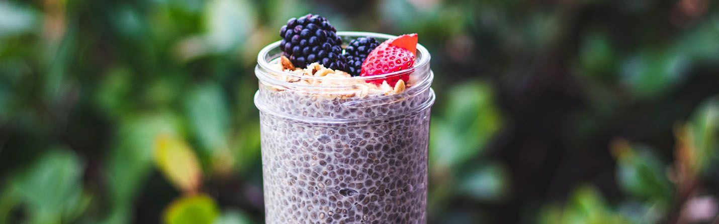 CBD chia seeds pudding with strawberries and muesli on it.