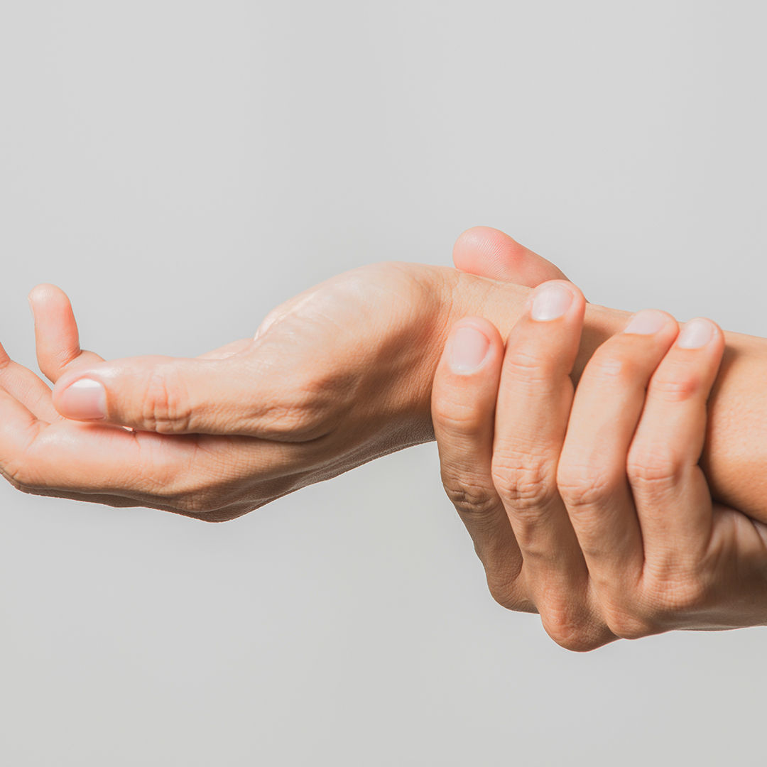 Man holding his hand from the pain