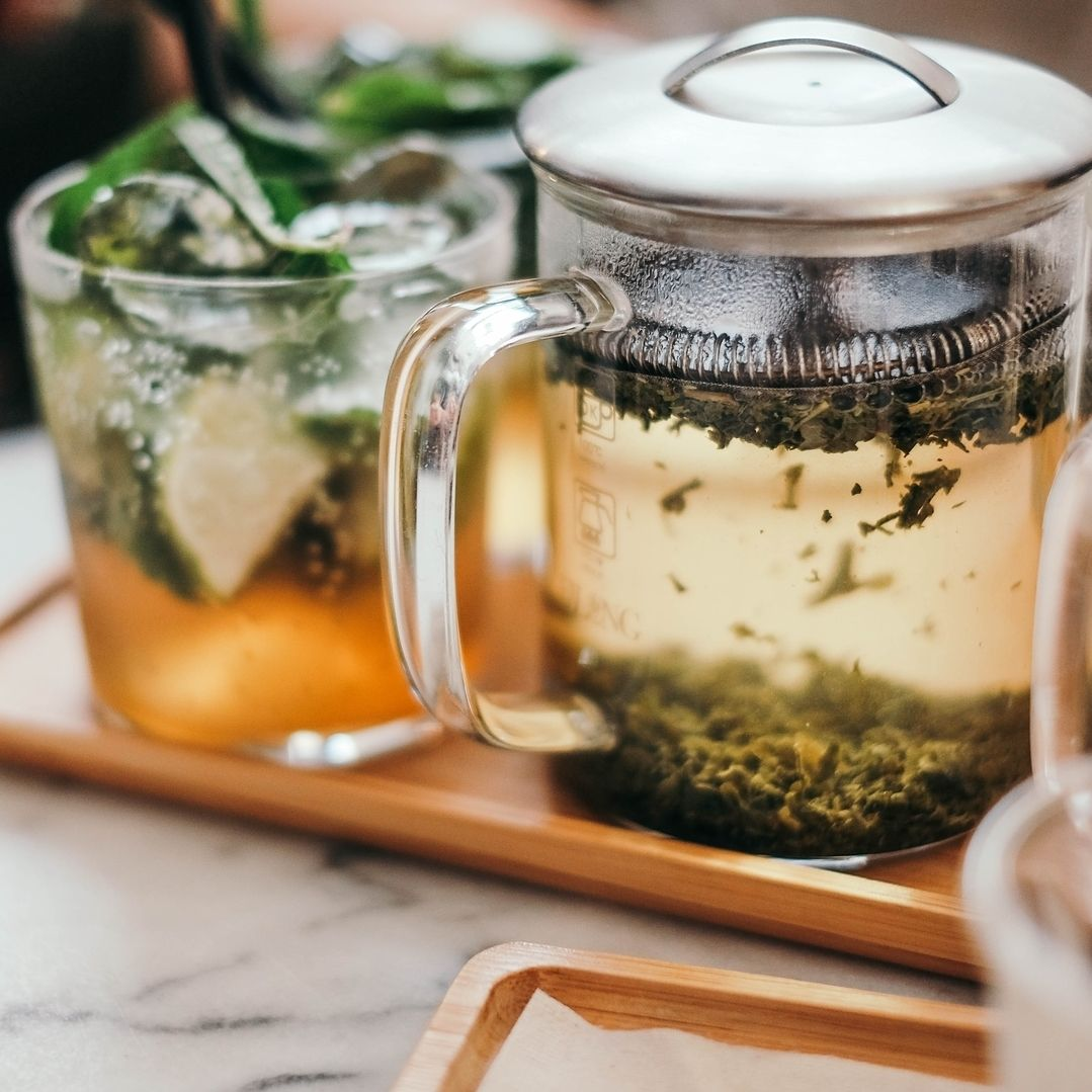 CBD infused herbal tea in a cup and teapot
