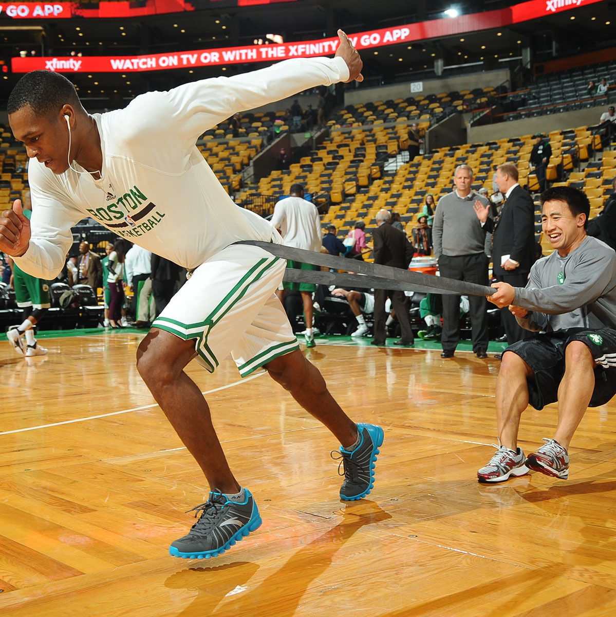 BOSTON, MA - NOVEMBER 11: Rajon Rondo #9 of the Boston Celtics works out with trainer Bryan Doo before the game against the Orlando Magic on November 1, 2013 at the TD Garden in Boston, Massachusetts.  NOTE TO USER: User expressly acknowledges and agrees that, by downloading and or using this photograph, User is consenting to the terms and conditions of the Getty Images License Agreement. Mandatory Copyright Notice: Copyright 2013 NBAE  (Photo by Brian Babineau/NBAE via Getty Images)
