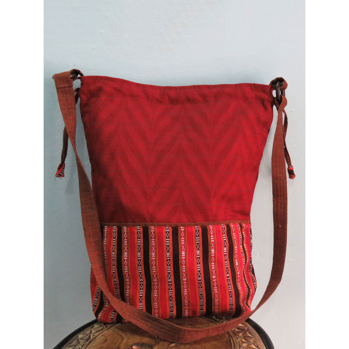 Red sling bag in potli stlye.