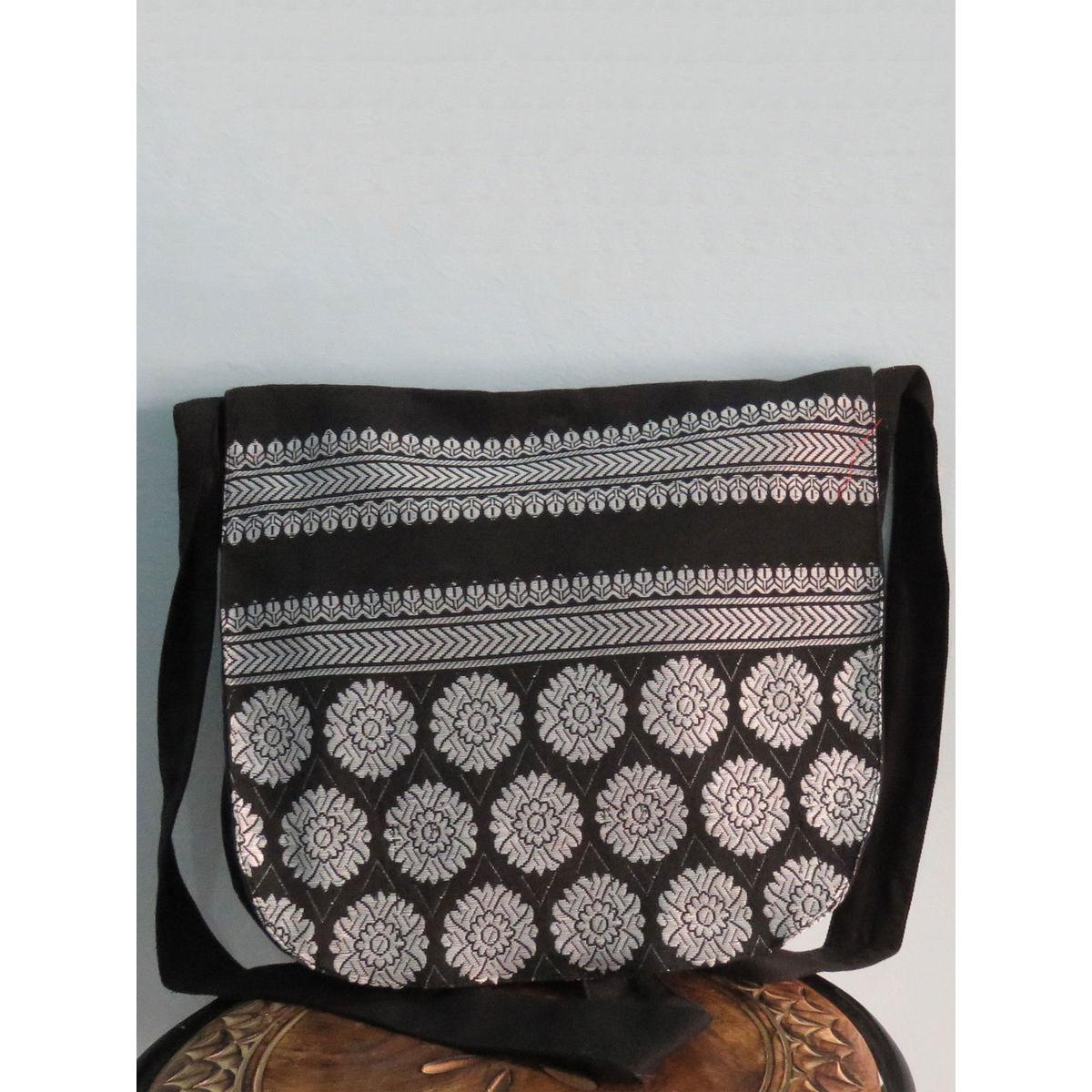 Black messenger bag with handwoven design.