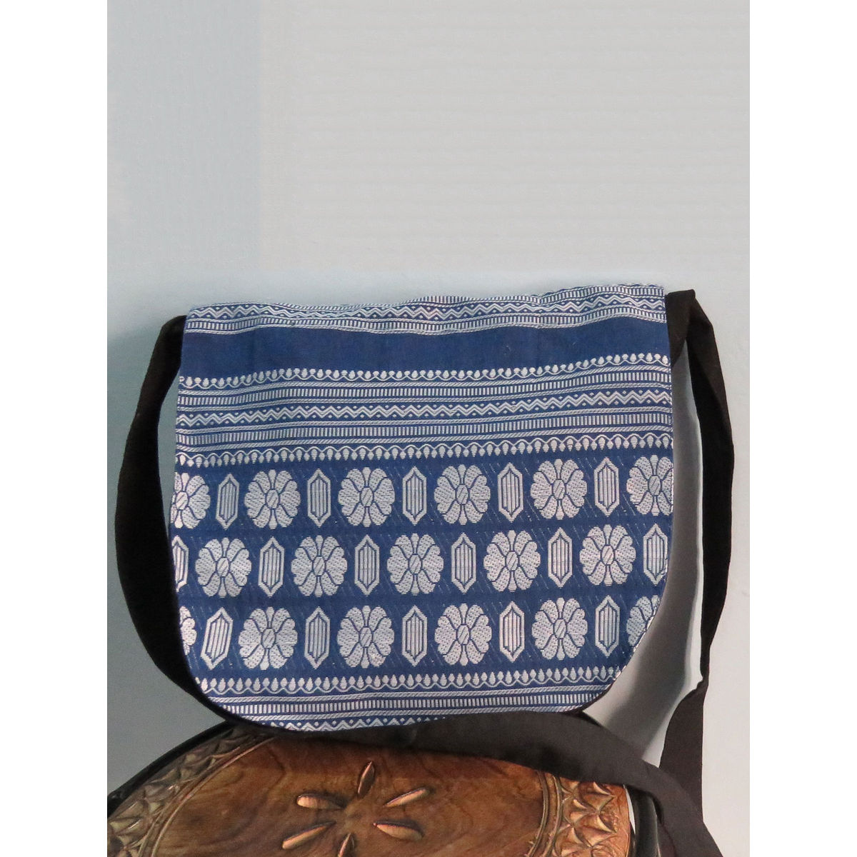 Indigo messenger bag with handwoven design.