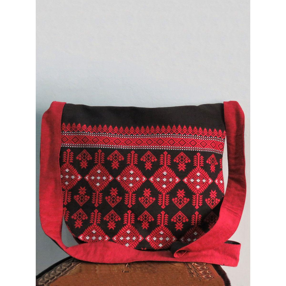 Black red messenger bag with handwoven design.