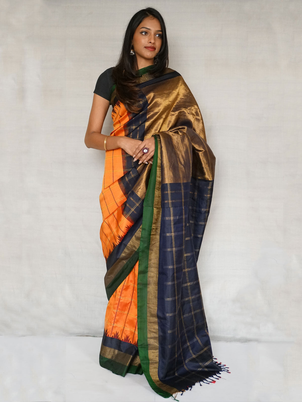 Pure South silk saree in orange and navy blue colour.With blouse.