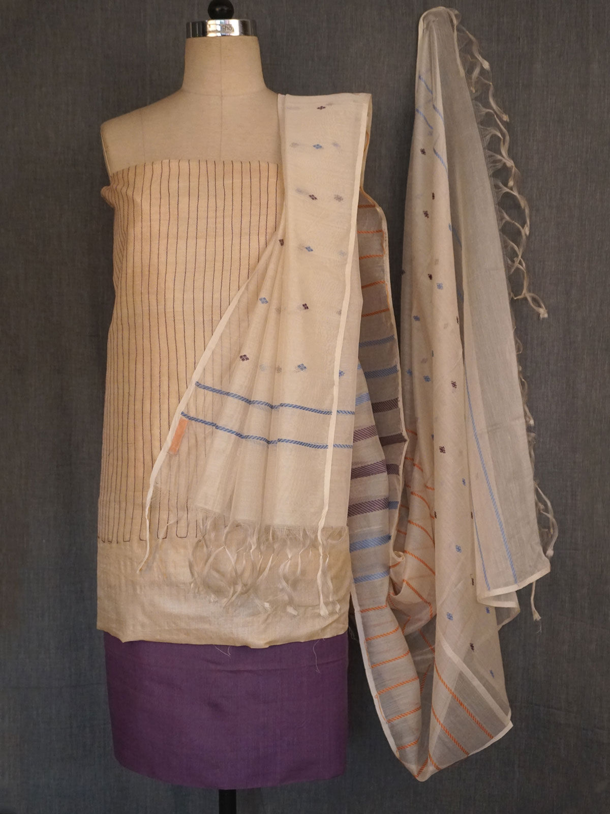 Off white  tusser dress material with purple stitch  lines with woven chanderi dupatta