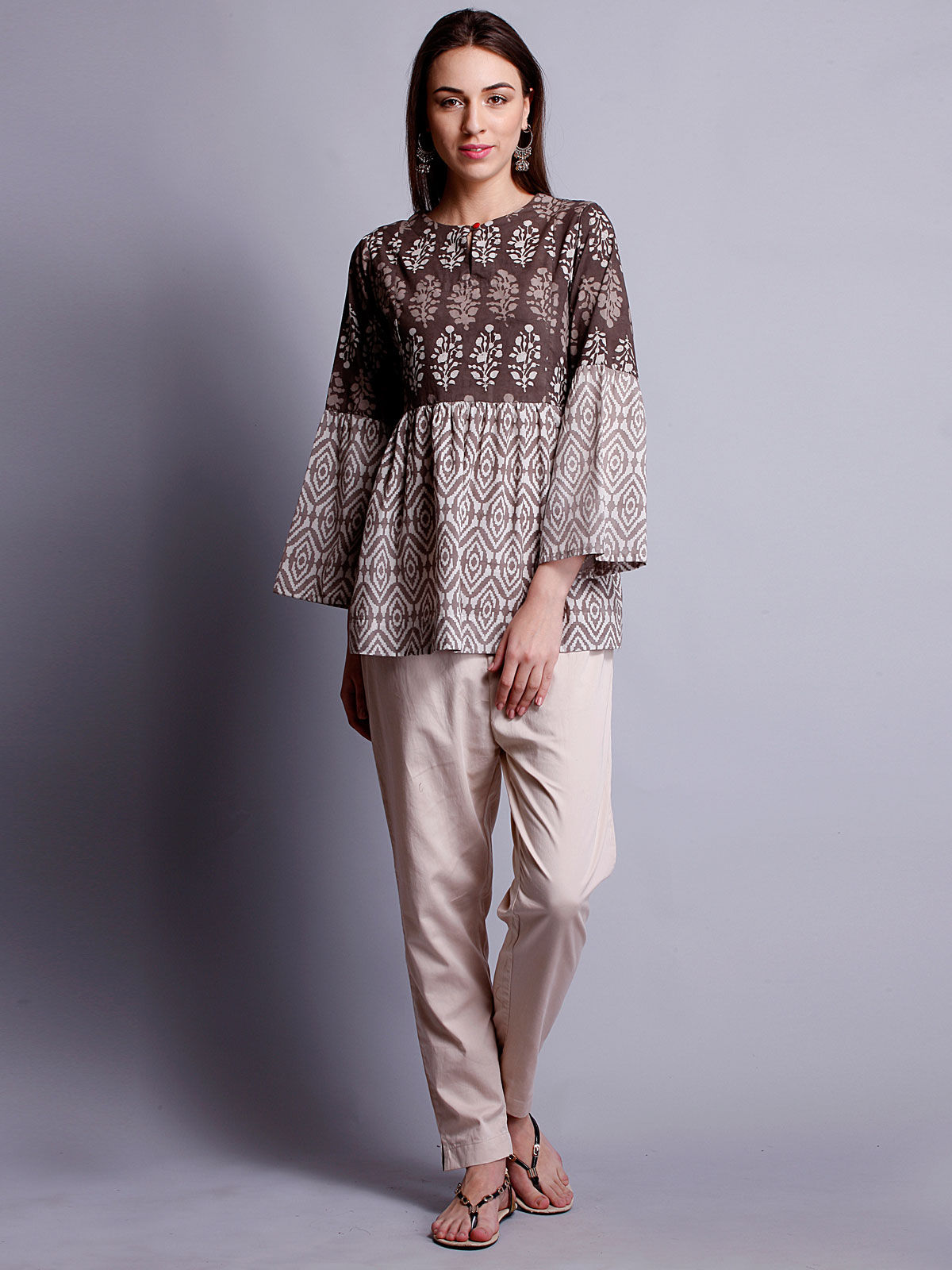 Full sleeves beige color block printed top